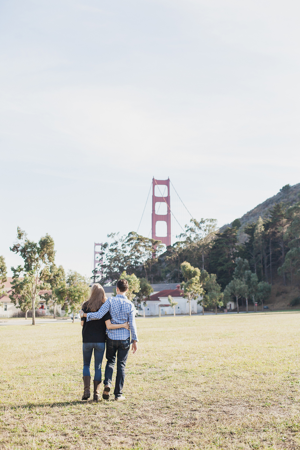 Couple walking during their engagement session at Cavallo Point in Marin, California.
