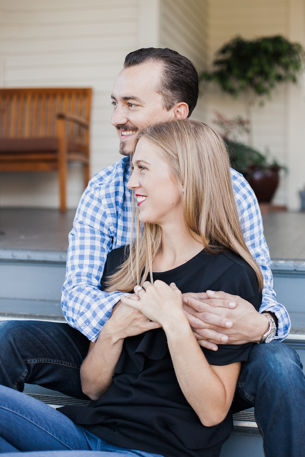 Couple sitting on steps during their engagement session at Cavallo Point in Marin, California.