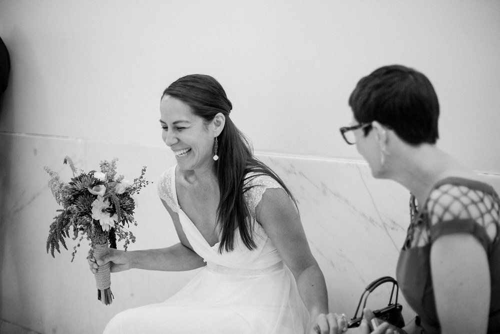 Bride laughing during her wedding in San Francisco City Hall.