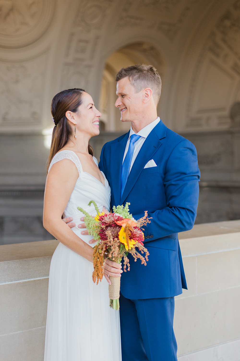 Bride and groom portraits after eloping in San Francisco City Hall.