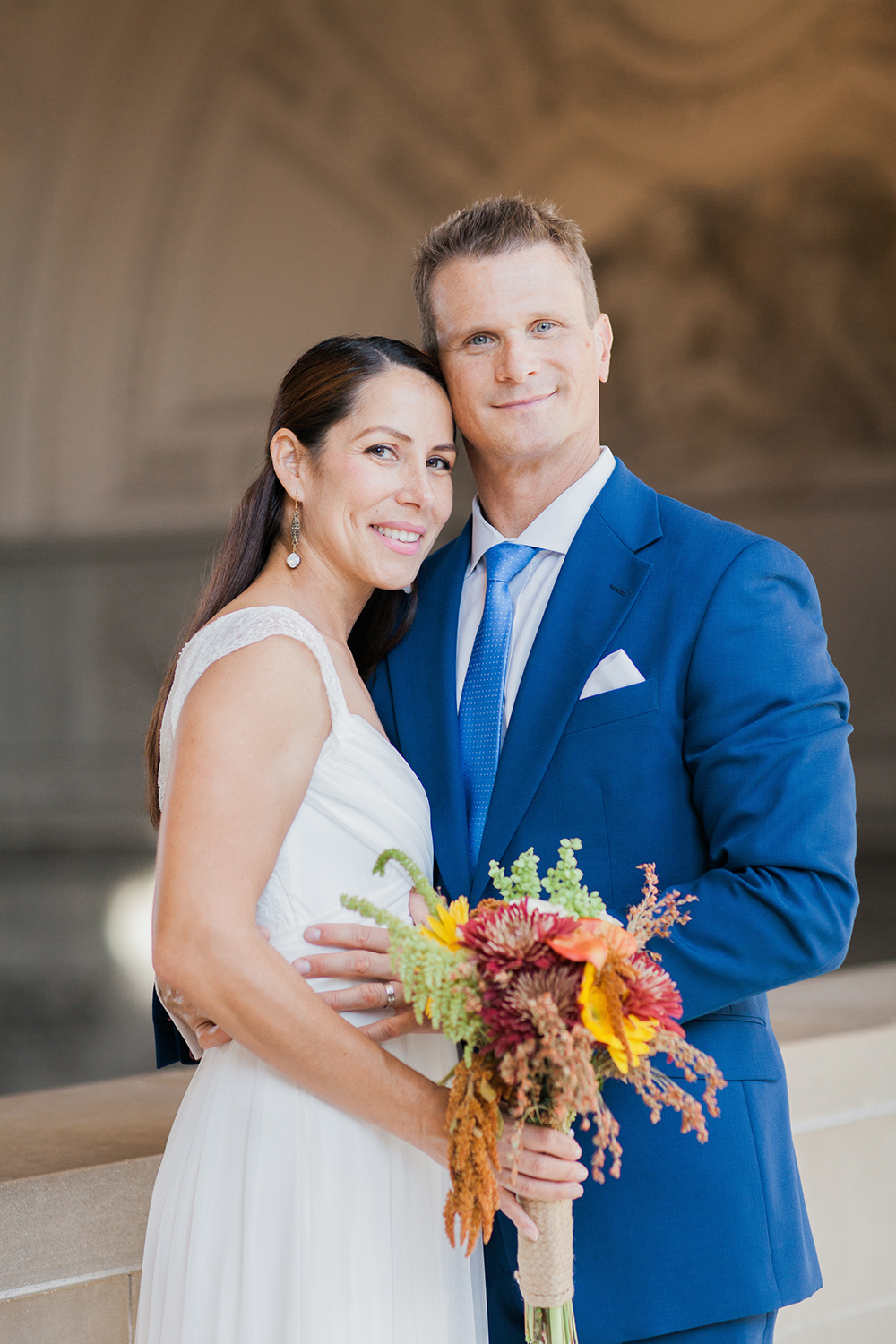 Simple bride and groom portraits after eloping in San Francisco City Hall.