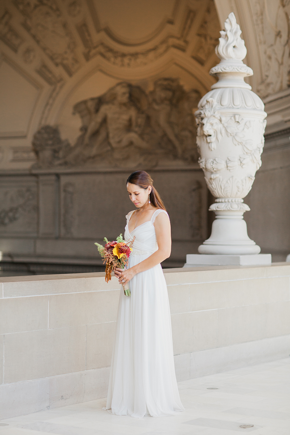 Simple portrait of bride after eloping in San Francisco City Hall.