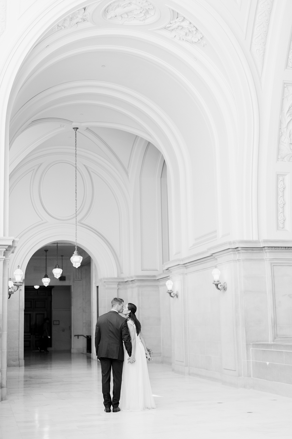 Classic portraits of bride and groom during their wedding in San Francisco City Hall.