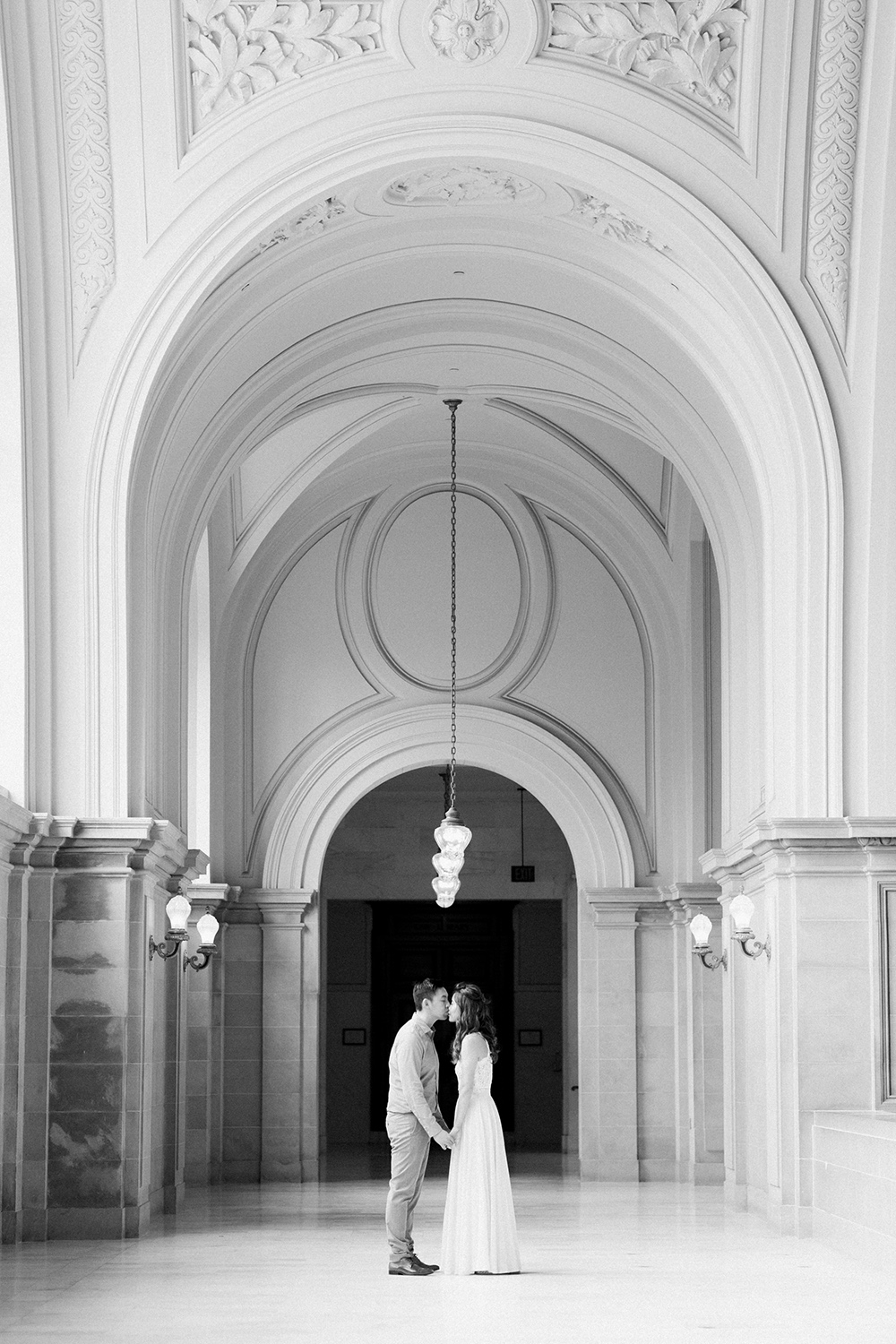 Megan and Michael's engagement session in San Francisco City Hall.