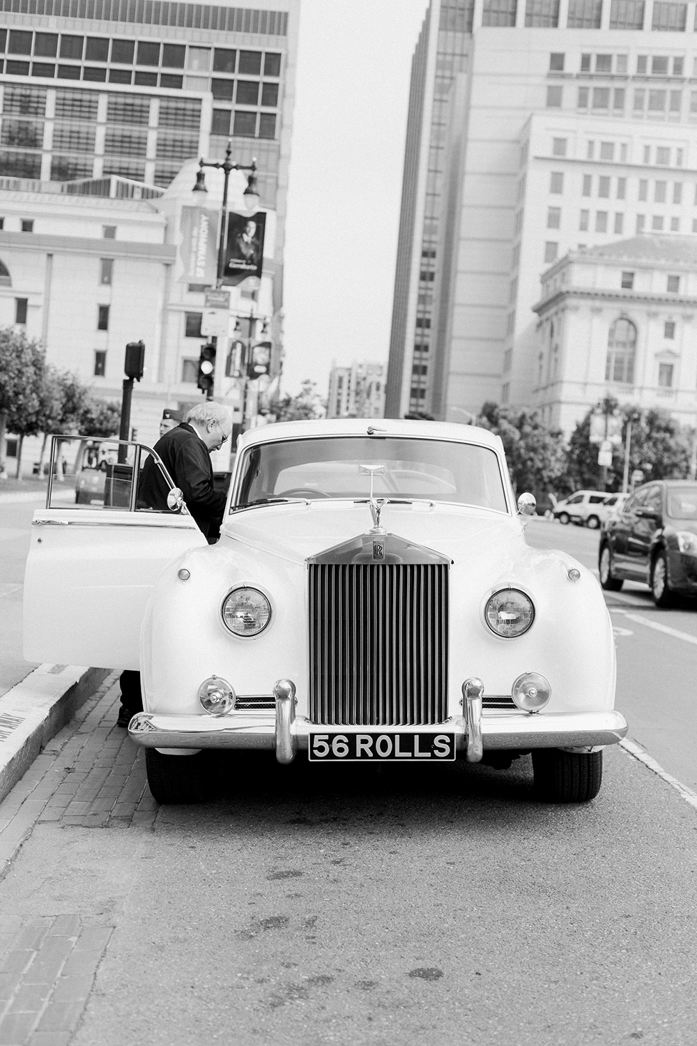 White Rolls Royce outside of San Francisco City Hall for Chris and Claire's wedding.