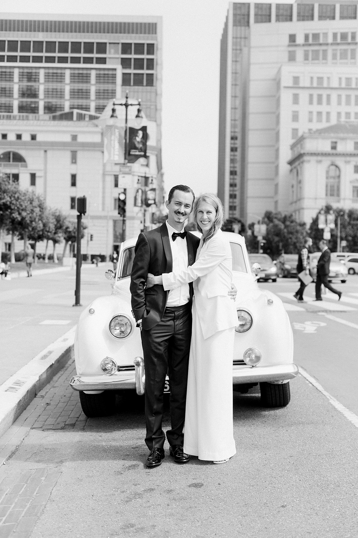 Bride and groom kissing outside their San Francisco City Hall wedding.