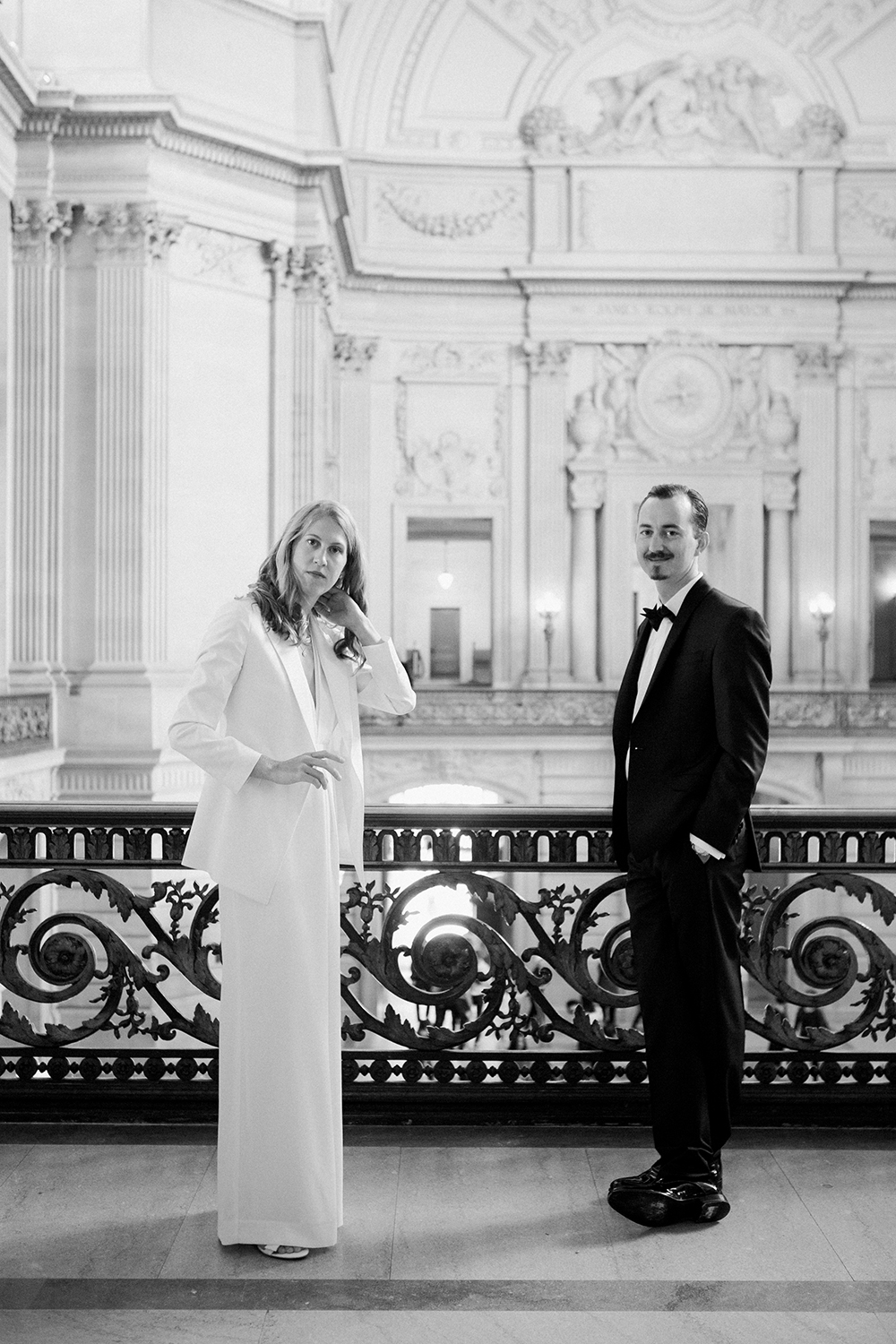Bride and groom waiting for their wedding ceremony in San Francisco City Hall.