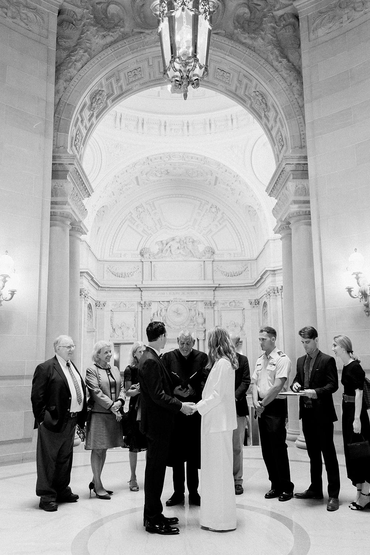 Intimate wedding ceremony in San Francisco City Hall's rotunda.