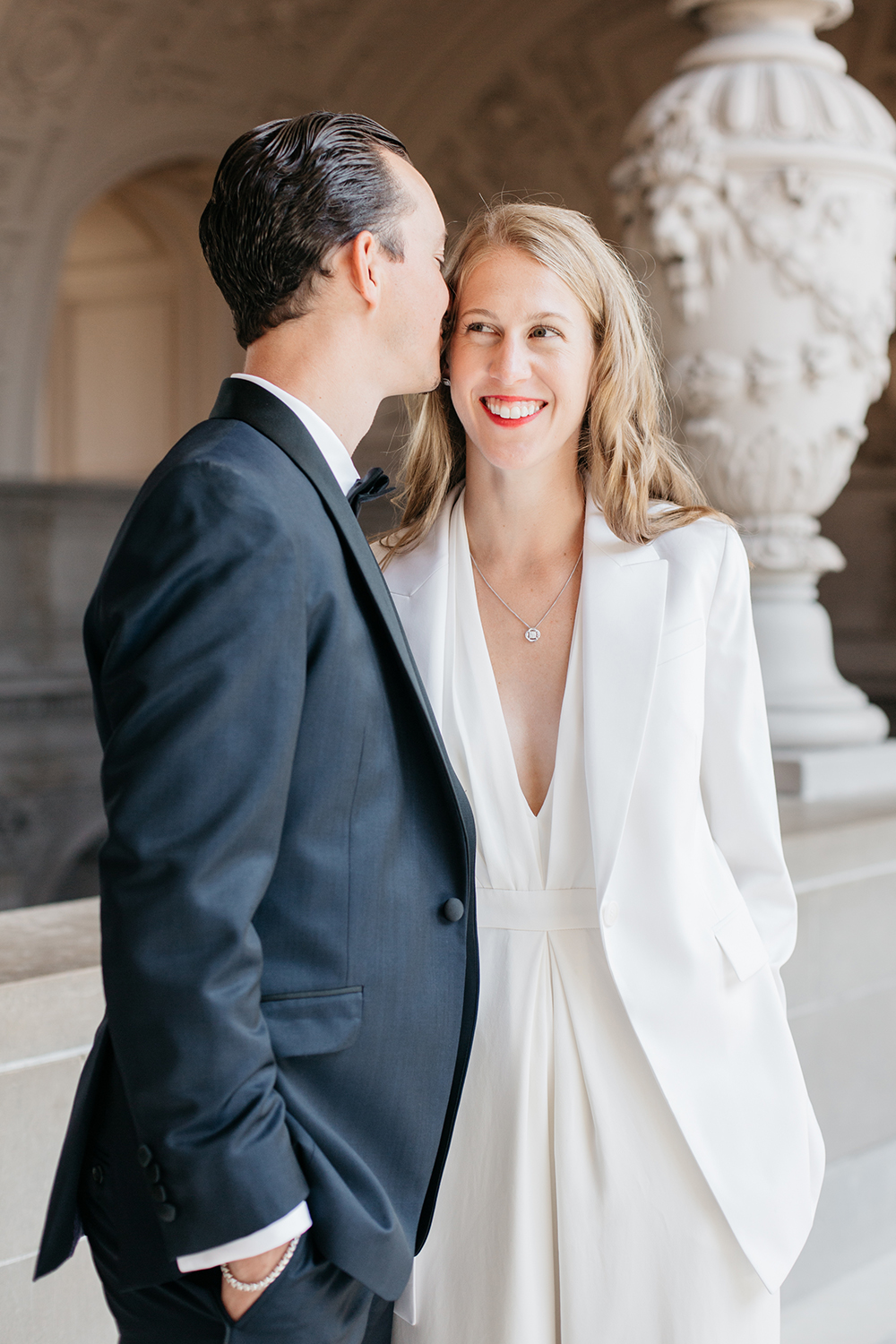 Candid portraits of bride and groom during their San Francisco City Hall wedding.