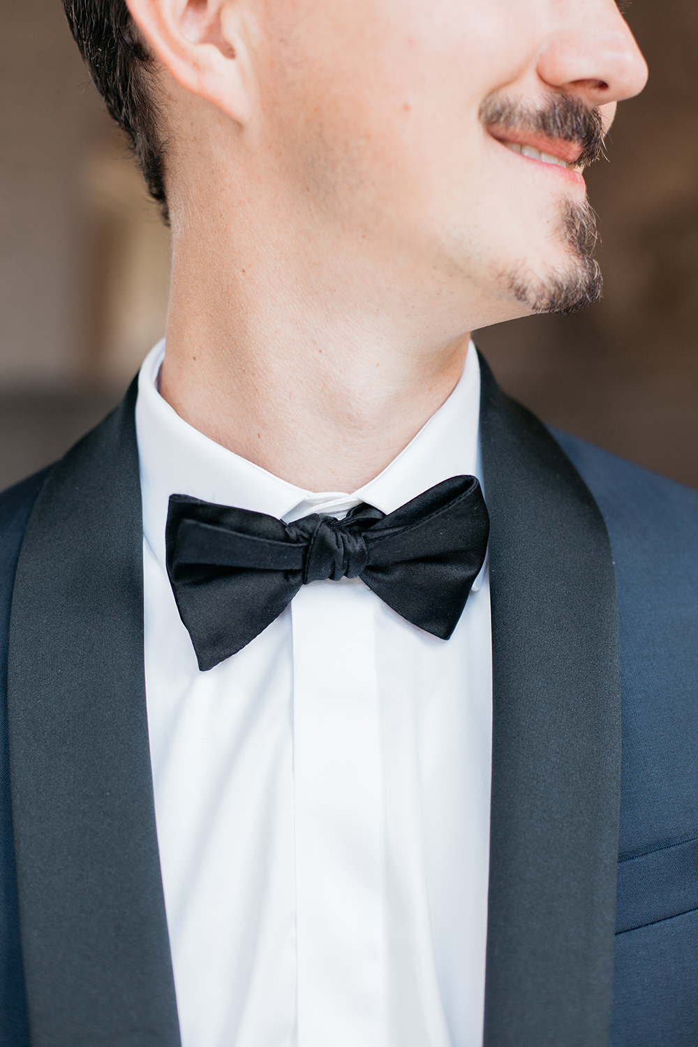 Groom suit and bowtie during his San Francisco City Hall wedding.