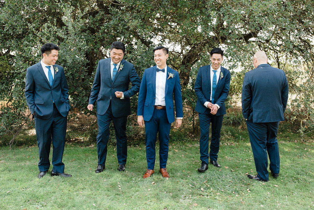 candid wedding photography of groomsmen at eagle vines golf club in napa california