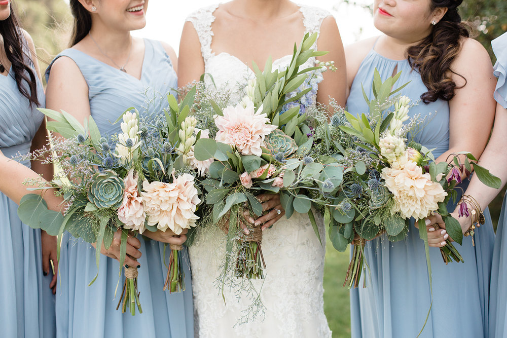 wedding photography of bridesmaids and bride flower bouquets at eagle vines golf club in napa california