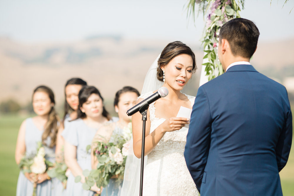 wedding photography of bride reading vows at eagle vines golf club in napa california