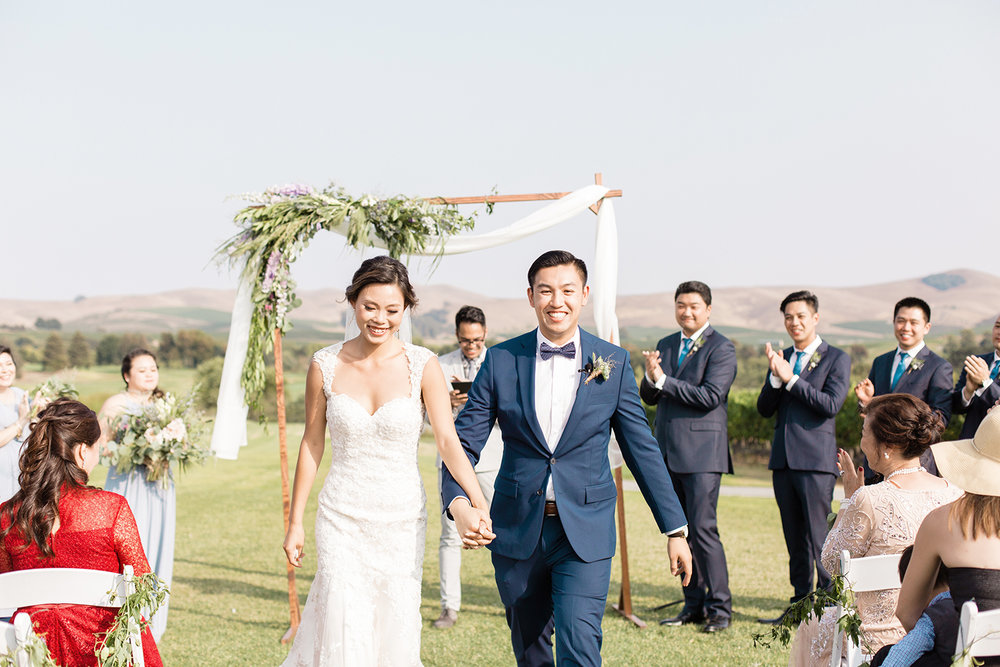 wedding photography of bride and groom first walk as husband and wife at eagle vines golf club in napa california