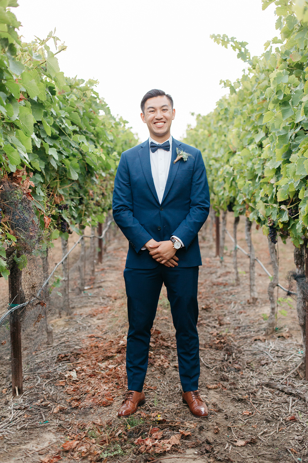 formal portrait of groom in vineyard wedding at eagle vines golf club in napa california