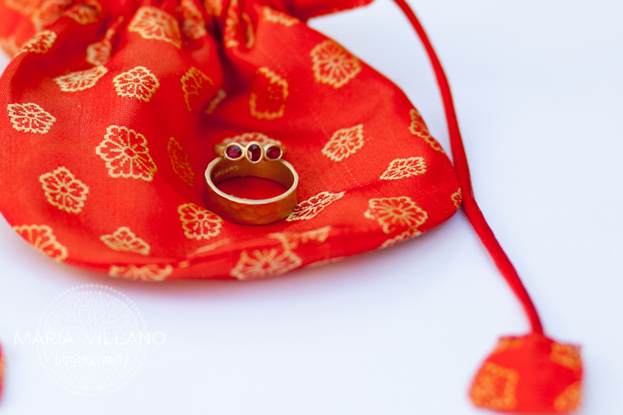 Wedding rings on red bag