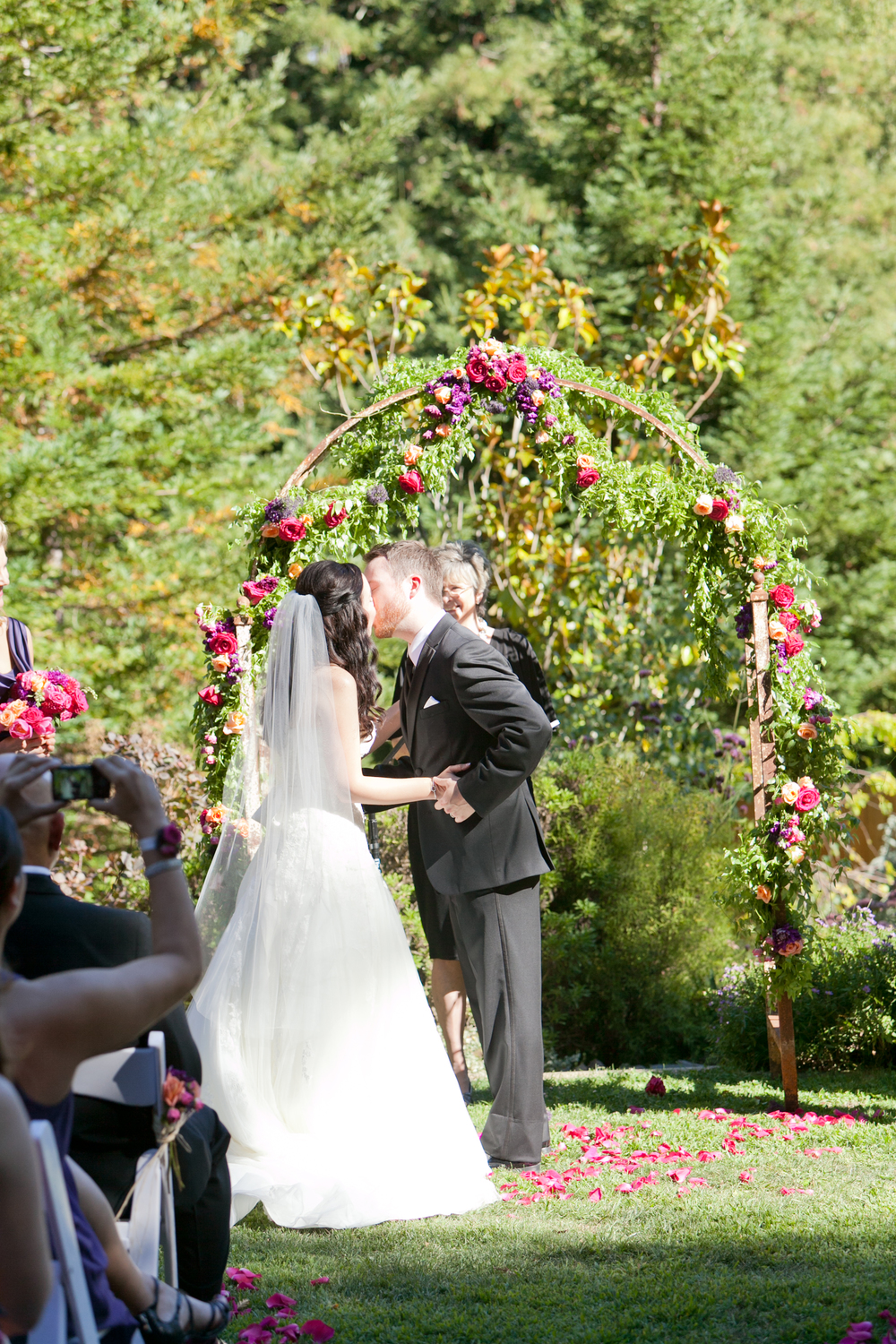 bride and groom kiss at redwood hills garden
