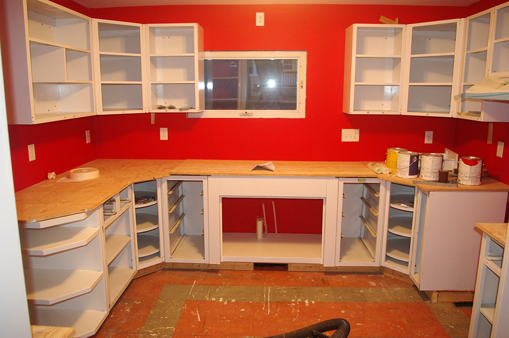 Here is a view of the entire kitchen, including the shelf.  You can see how the angle of the shelf matches the angle of those corner lazy Susan cabinets.