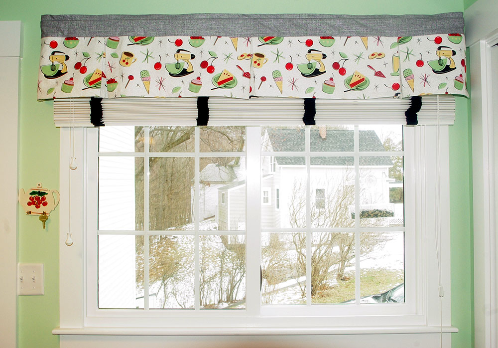 The window valance in the eating area.  The wooden blinds are Hunter-Douglas blinds from The Linen and Shade Bin, in Milford, NH.