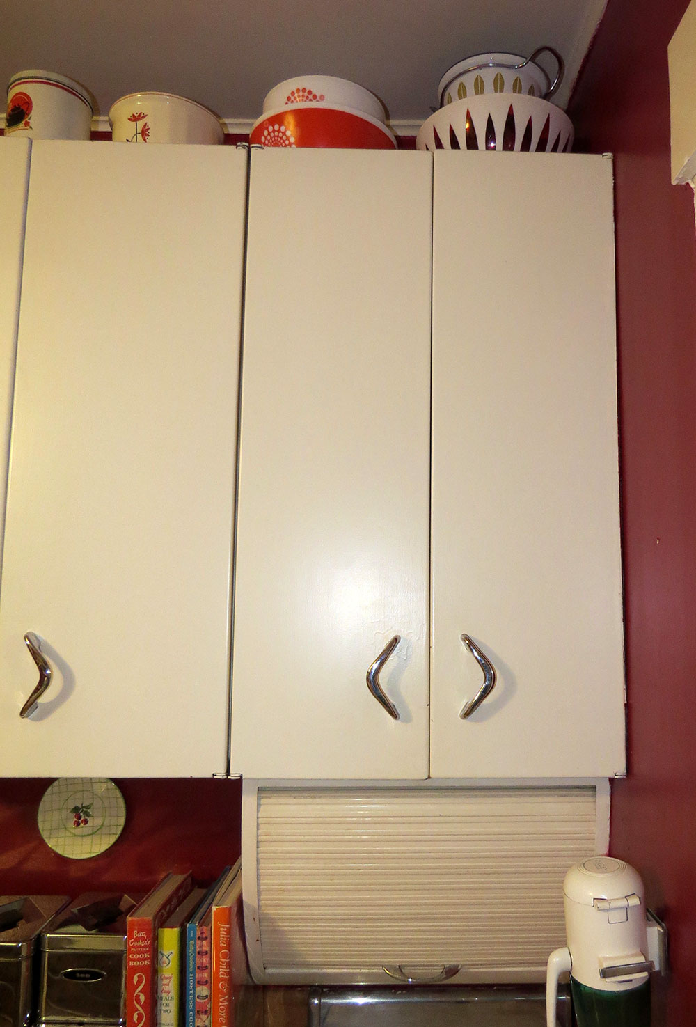 Upper cabinets with roll-top spice rack
