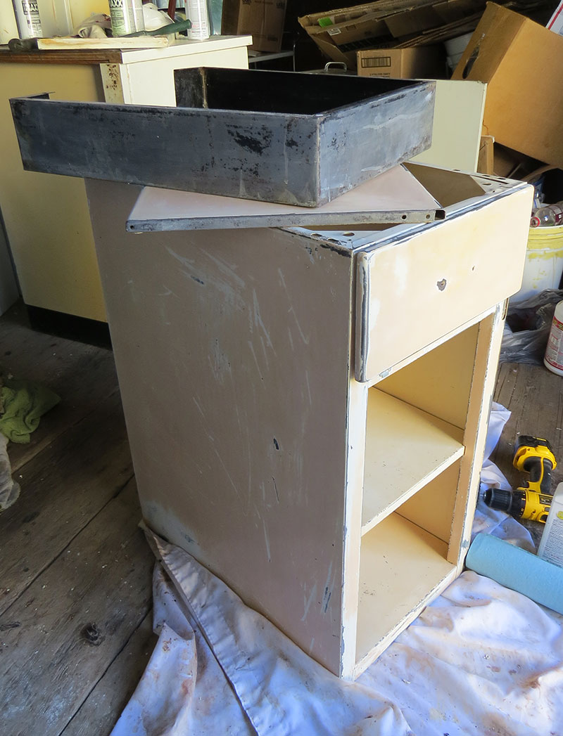 Lower cabinet stripped and ready to be painted.