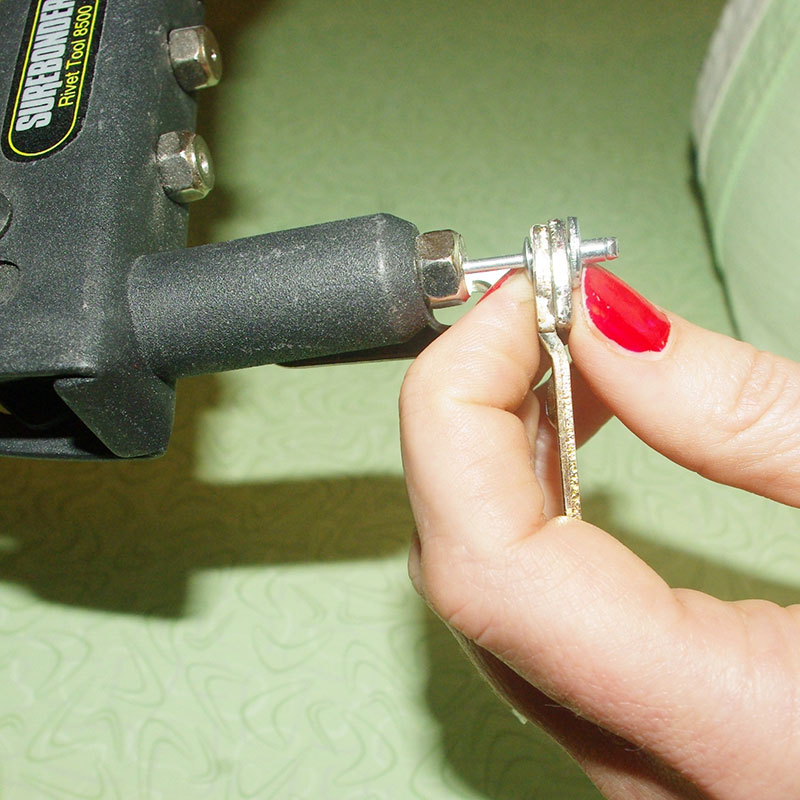 Step 6: Insert the long end of the riveter into the rivet tool.