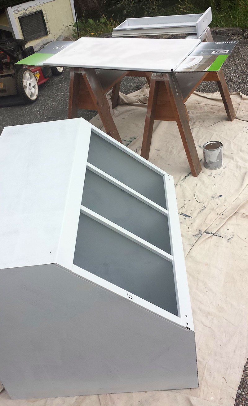 Upper corner cabinet and door primed and ready to paint.