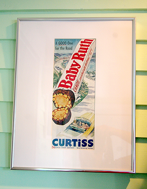 A framed magazine ad for Baby Ruth, from the Curtiss Candy Company (no relation).  This currently hangs in our new eating area.