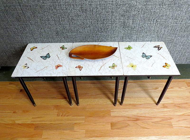 These stacking butterfly tables were in my Dad's home growing up.  They make a great table behind the couch.