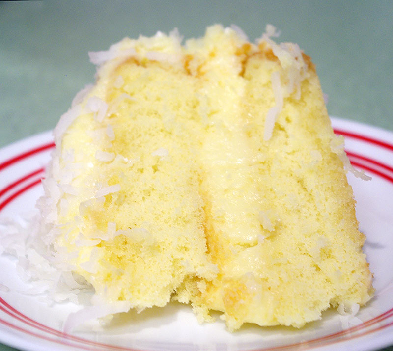 A slice of coconut cake with coconut pastry cream