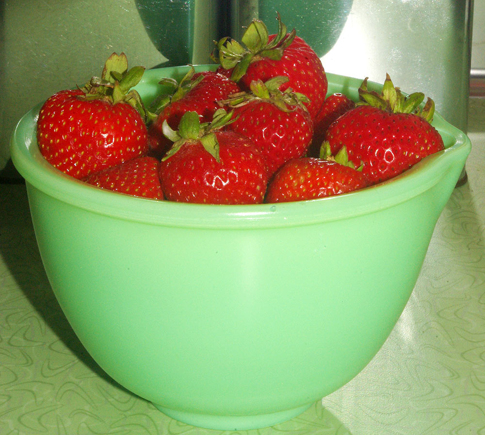 Fresh strawberries in a vintage jadeite bowl