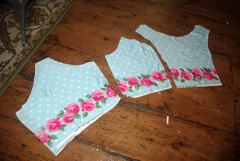 The bodice pieces lined up on the smaller border print.