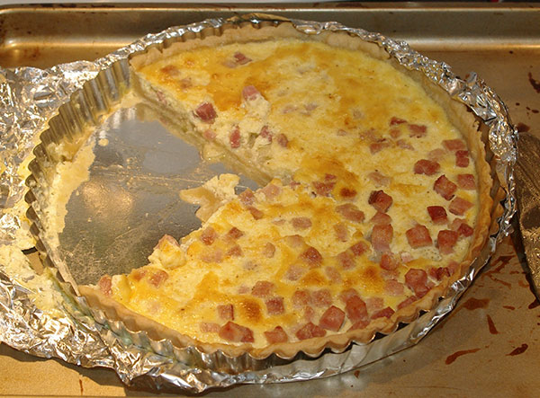The finished quiche.  Much of the filling on the right-hand side had drained out so the ham is much more visible.