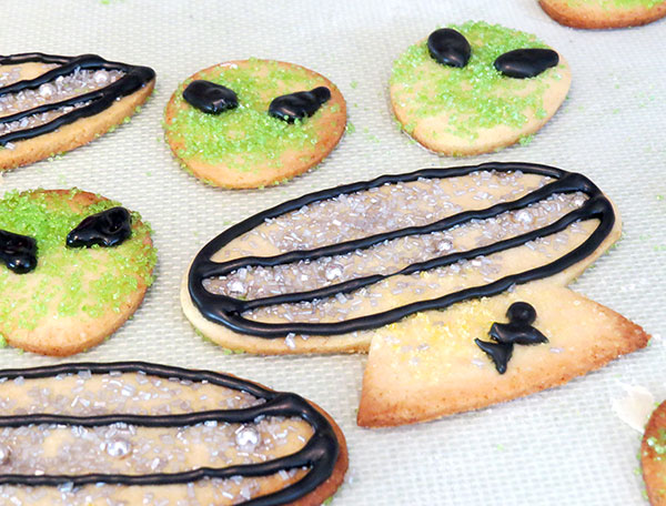 Baked and decorate alien and UFO cookies.