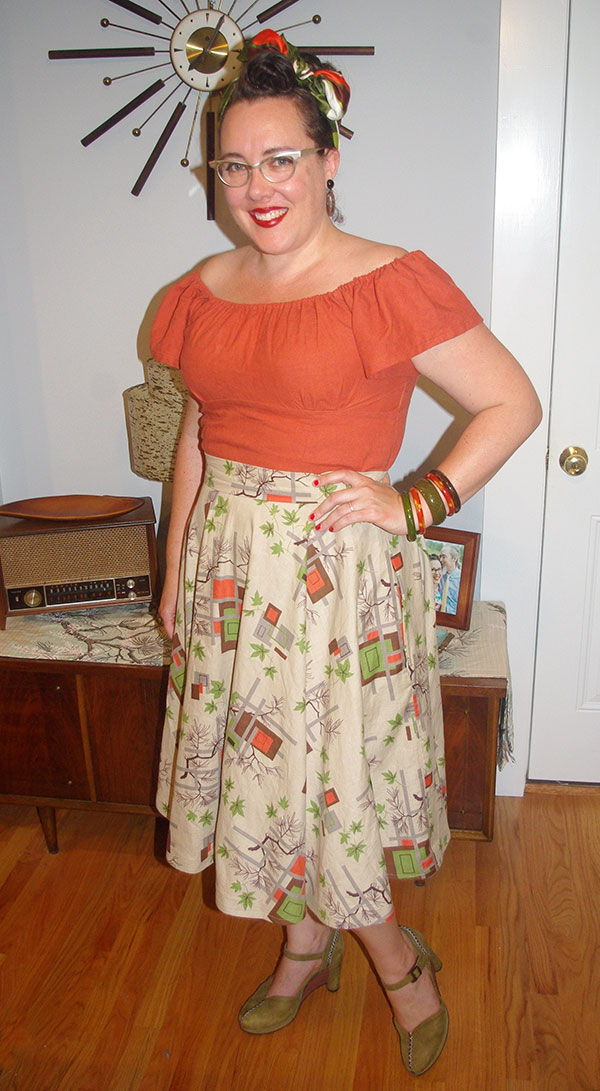My orange flutter-sleeved blouse with a matching circle skirt I made a few years ago.