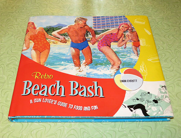 """Retro Beach Bash: A Sun Lover's Guide to Food and Fun"" by Linda Everett."