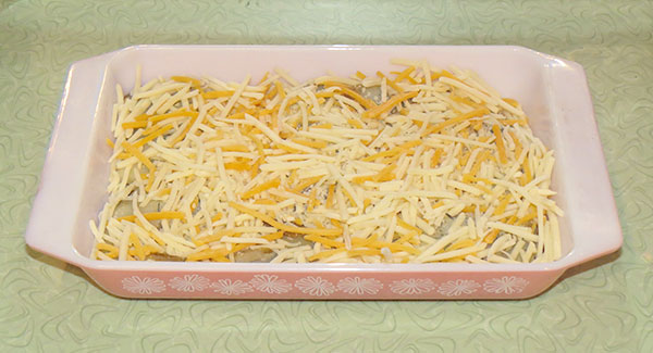 Grated cheese, which makes the dish delicious, but not particularly healthy
