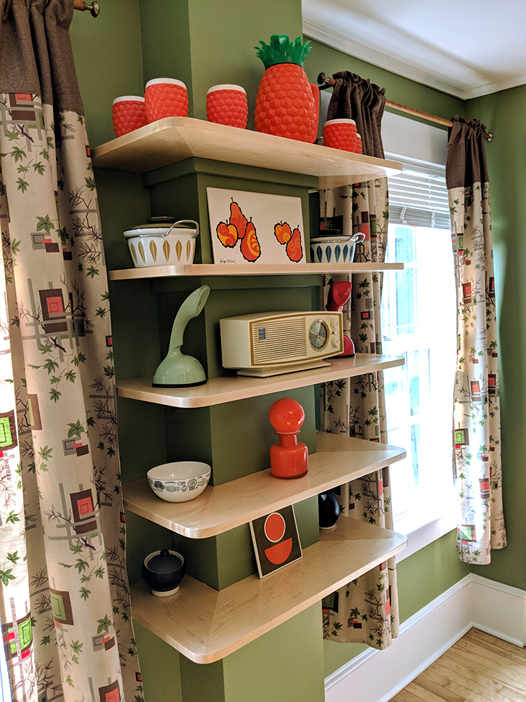 The final built-in shelving displaying some of our mid-century items.