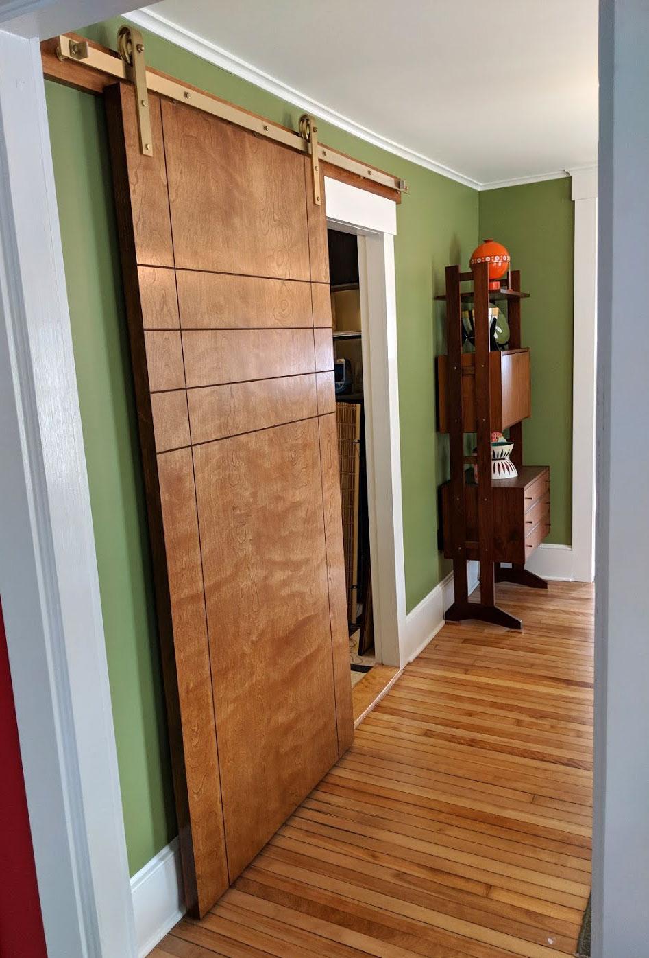 The sliding door opened.