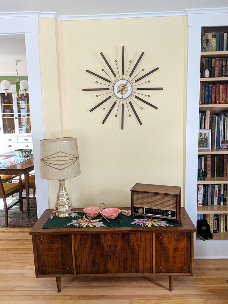 One of our starburst clocks and mid century sideboard.  The vintage radio belonged to my grandmother.
