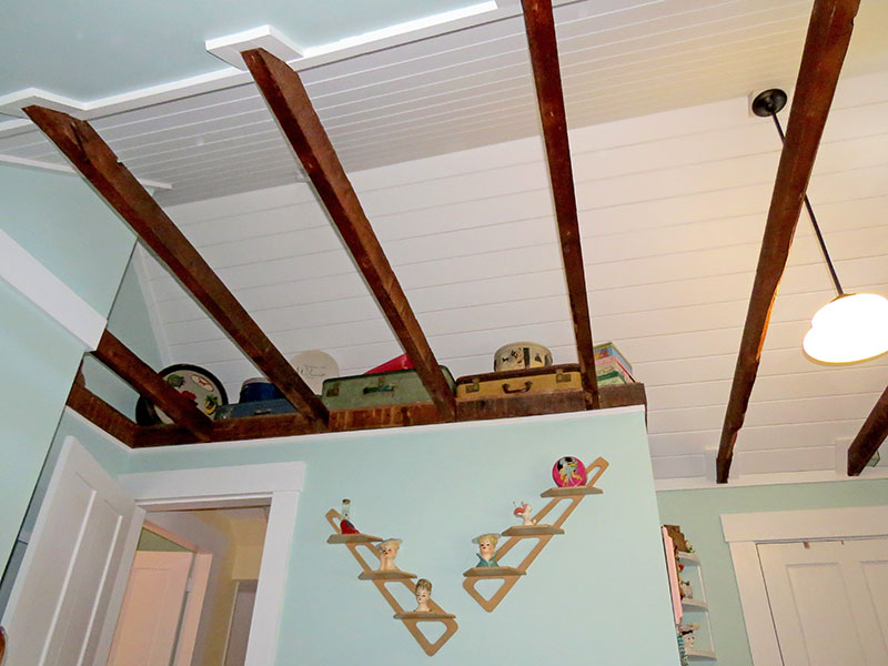 The vaulted ceiling with exposed original beams.
