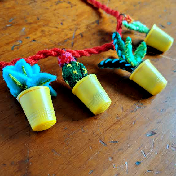 The finished potted plants necklace with plants and cacti