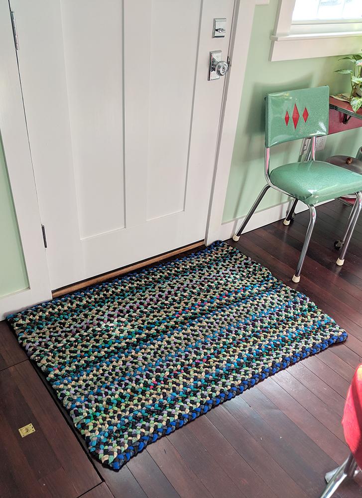 The final rug in front of the door