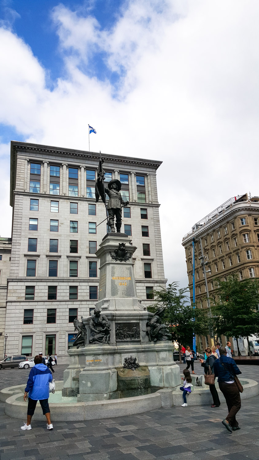 Place d'Armes with the monument honoring Paul de Chomedey, Sieur de Maisonneuve who was a French military officer and founder of Montreal.