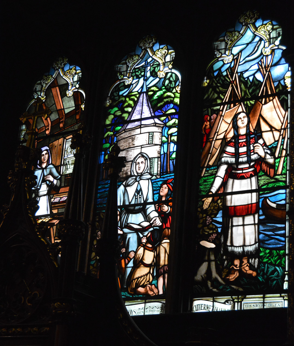 Stained glass depicting religious history of Montreal.