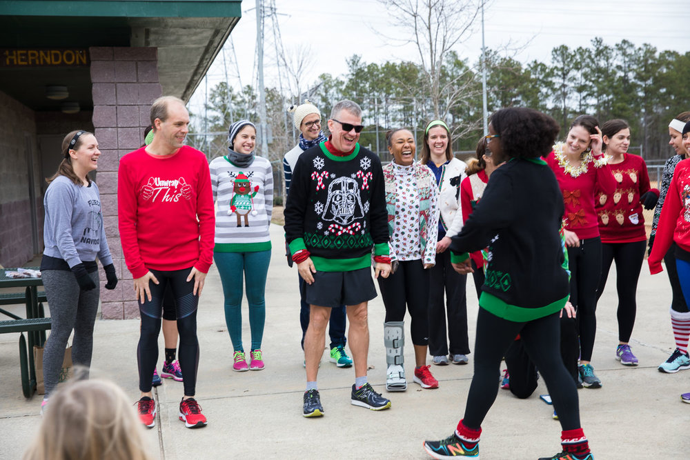 That moment you realize you're wearing the exact same sweater as someone else at a tacky sweater fun run