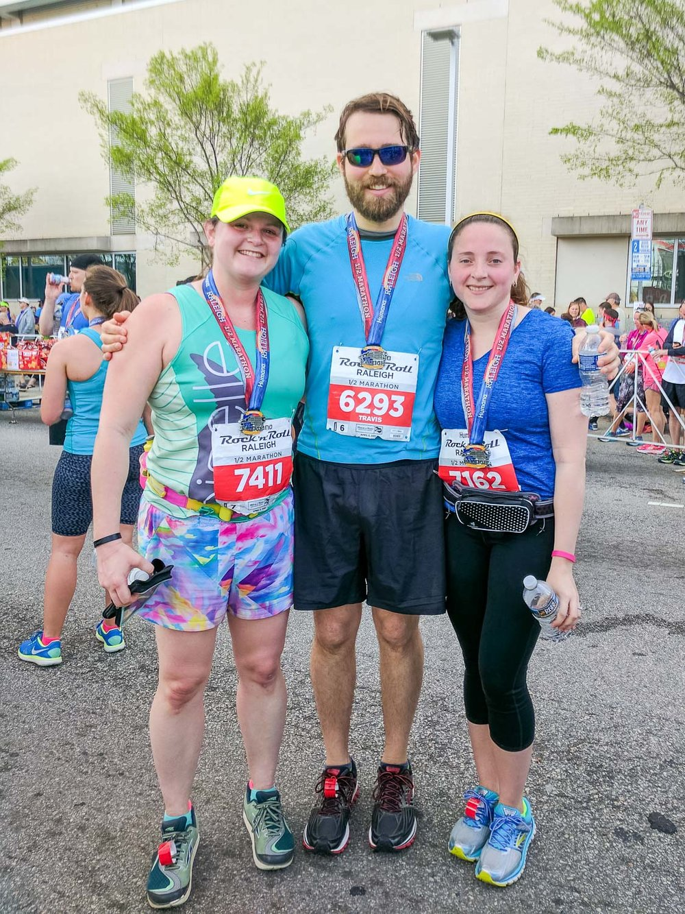 Finish line photos! Kristen is smiling because she PR'ed, congrats Kristen! Also, see how those race bibs are way too big and our running belts don't work with the bibs? Really now, tsk tsk.