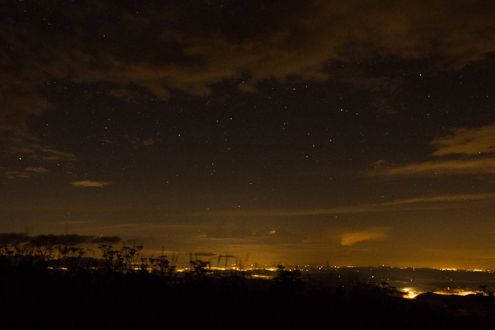 View of Brevard and night sky with clouds from Black Balsam Knob