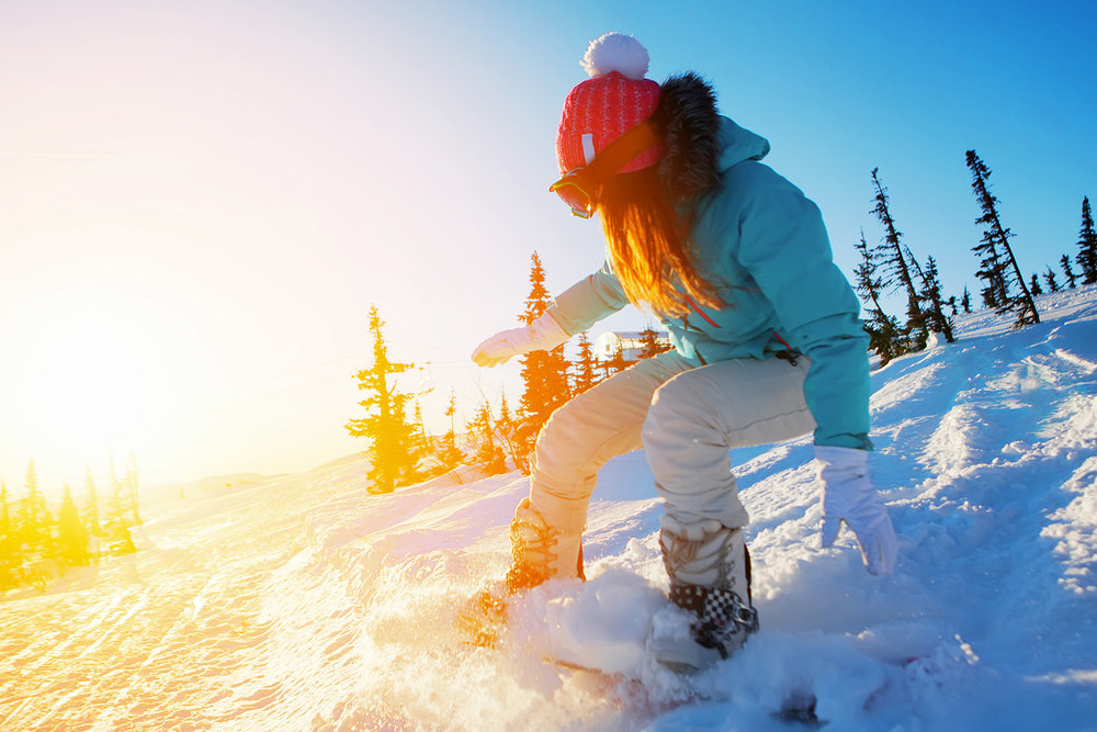 Snowboarding is a popular winter sport. Licensed photo from Adobe Stock.