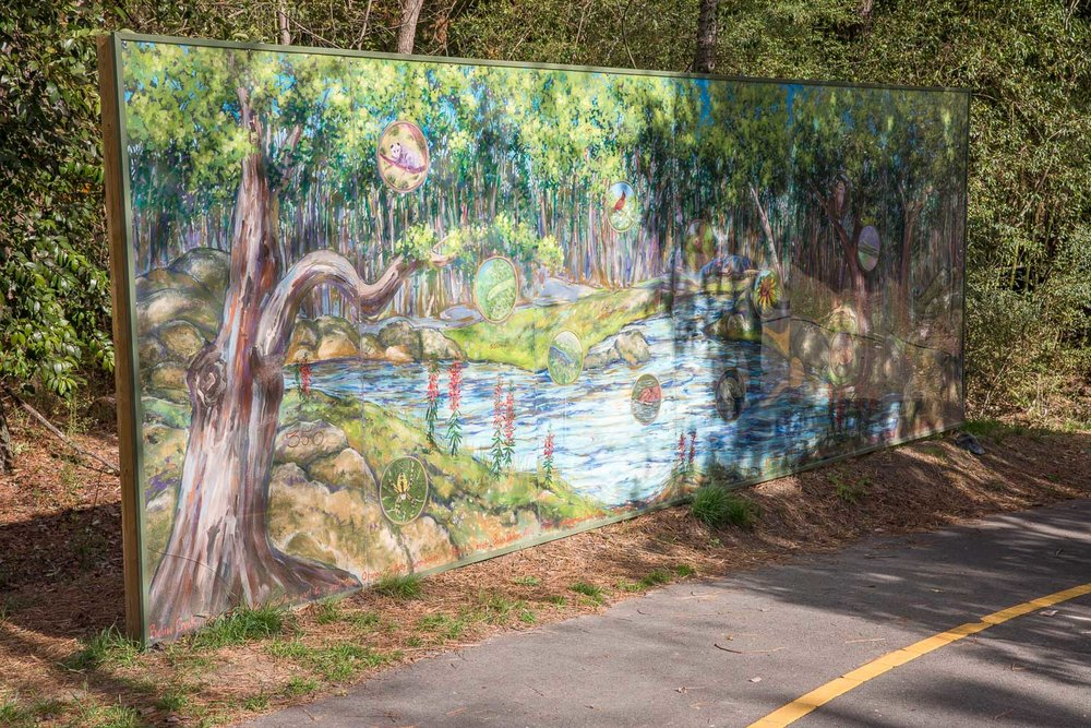 Mural along paved greenway before reaching the natural trails of Adams Tract